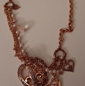 Not sure Jewelry - Rose gold look earrings and necklace